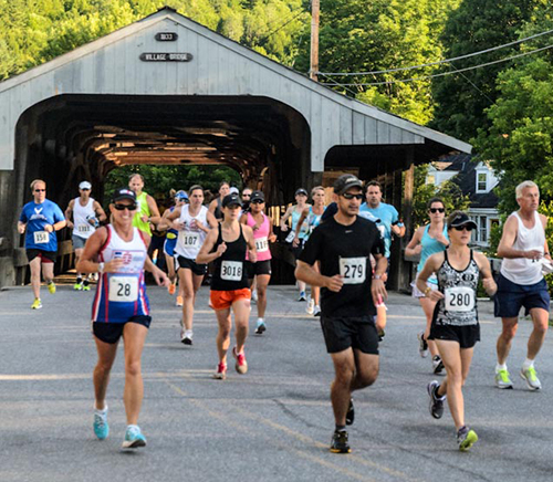 Mad Marathoners crossing the Waitsfield covered bridge. Photo: Rhoady Green
