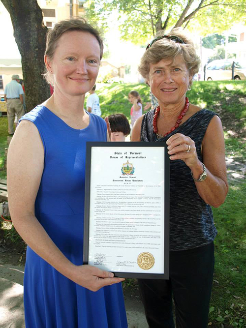 Librarian Joy Worland and Board Chair Jean Joslin with the Resolution for library from the Vermont Legislature