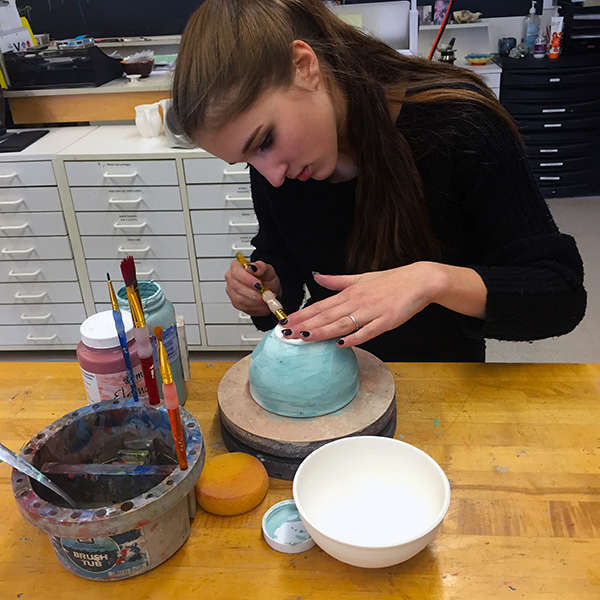 Madison D'Amico, a Harwood student, prepares a bowl for the annual Empty Bowl dinner.