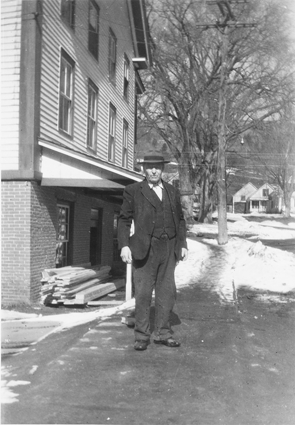 Elmer Mehuron's father-in-law, Dr. Carlos Shaw, the town doctor, is pictured standing down the street from Mehuron's Independent Grocery Store.