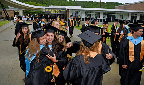 Harwood graduates celebrate the end of school. Photo: Gordon Miller