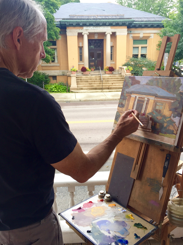 Artist Phil Laughlin painted the Joslin Memorial Library as part of the Plein Air painting event last week. Photo: Rebecca Silbernagel