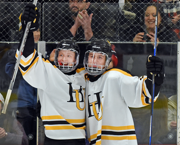 Eli Rivers and Ryan Garrand celebrate after scoring in their win over Bur & Burton on their way to the state championships. Photo: Gordon Miller