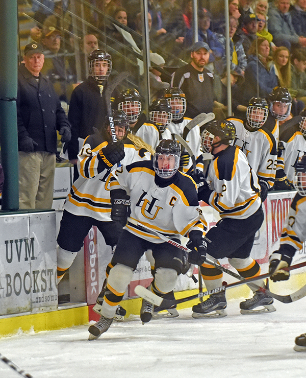 Eli Rivers leads the line change for Harwood during Vermont's Division II state championship game against North Country Union. Photo: Gordon Miller