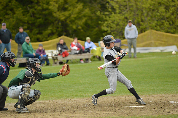 Harwood's Charles Zschau gets a hit during Harwood's 8-3 victory over Montpelier. Photo: Chris Keating