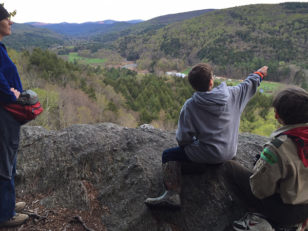 Scouts look out at the Mad River Valley from the Wu Ledges in Waitsfield. Photo: AnnMarie Harmon