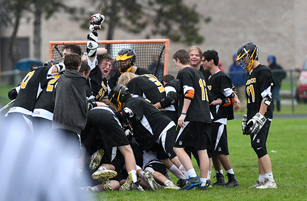 Harwood boys lacross celebrates their 14-8 win over Milton propelling them to the championships in Burlington against rival Stowe. Photo: John Williams