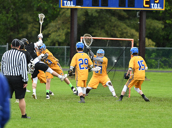 Noah Williams shoots on goal during Harwood's 14-8 D2 semi-final win over Milton. Photo: John Williams