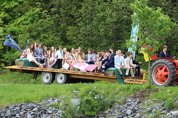 Green Mountain Valley School students ride into graduation.