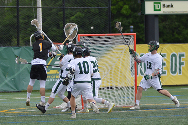 Harwood's Noah Williams (No.1) scores one of Harwood's goals during their championship game against Stowe. Stowe won 13-10. Photo: Chris Keating