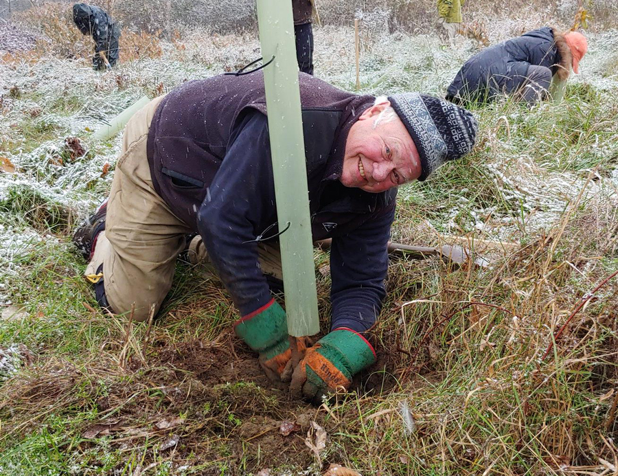 Bob Cook of Waitsfield planting trees as part of a floodplane restoration project. Photo: Corrie Miller