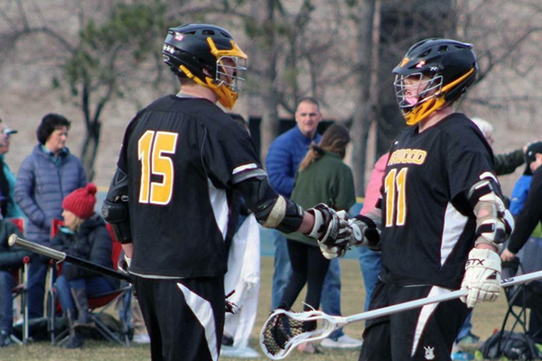 Harwood lacrosse team members Jake Wells and Oli Hammond congratulate each other.
