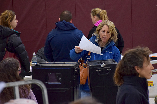 Waitsfield voter Kate Williams casts her ballot at the 2016 Waitsfield Town Meeting. Photo: Jeff Knight