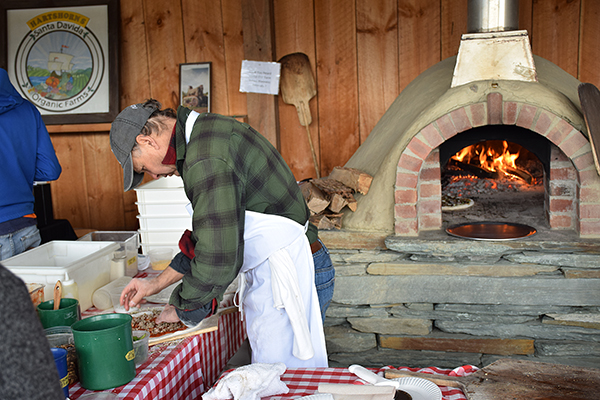 George Schenk of American Flatbread in Waitsfield fires it up at the first Maple fest at Hartshorn Farmstand in Waitsfield. Photo: Jeff Knight