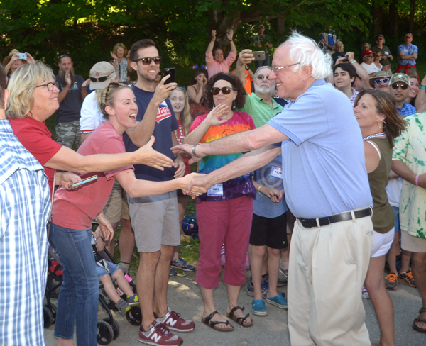 Vermont Senator and United States Presidential Candidate Bernie Sanders greets supporters at the Warren Fourth of July Parade. Photo: Sandy Macys