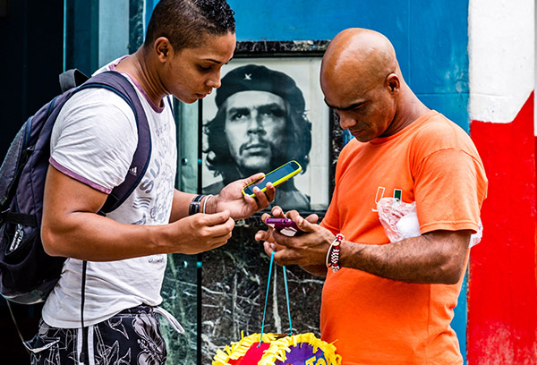 Internet users at a public WiFi hot spot in Central Havana in 2015. Photo: David Garten
