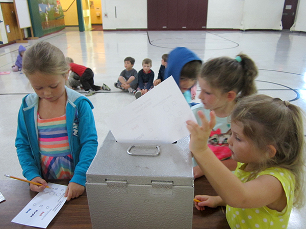 Waitsfield Kindergartners vote on next year's dog licenses. Photo: Jennifer Peterson