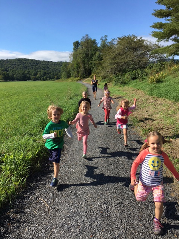 "School children enjoy the new ""Waits Way"" section of the Mad River Path behind the Waitsfield Elementary School."