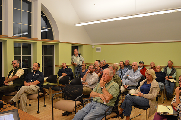Waitsfield residents listen to plans to develop a park next to the covered bridge. Photo: Chris Keating