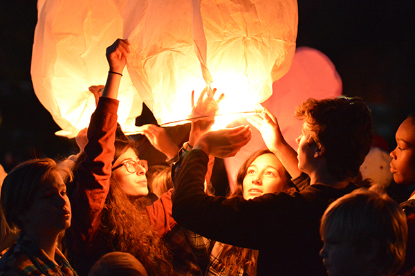 Students send lanterns into the sky to remember friends and loved ones. Photo: Chris Keating