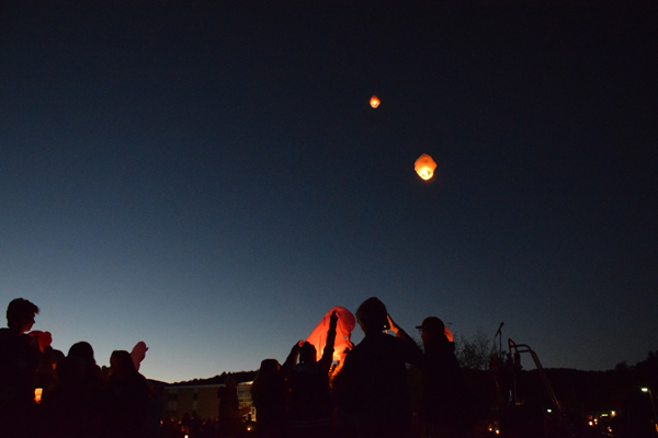 Lanterns float into the sky as part of a memorial vigil held at Harwood for students killed over the weekend. Photo: Jeff Knight
