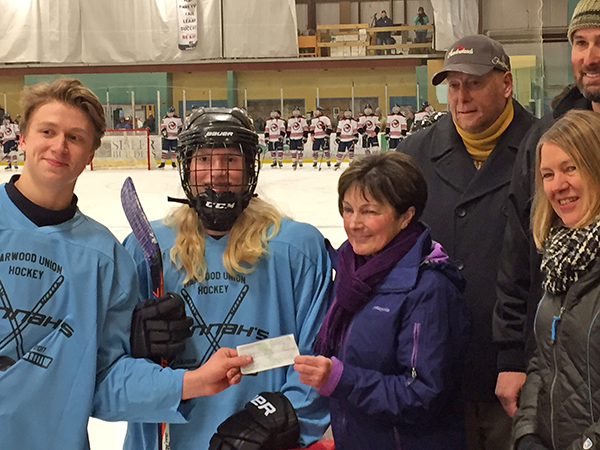 Harwood Hockey featured nonprofit Hannah's House at a game on February 8, 2017. Hannah's House revived a donation of over $700.