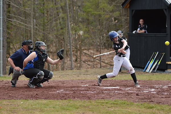 Harwood catcher, Cheyenne Martindale, hits a single against Thetford on April 27. Photo: Chris Keating