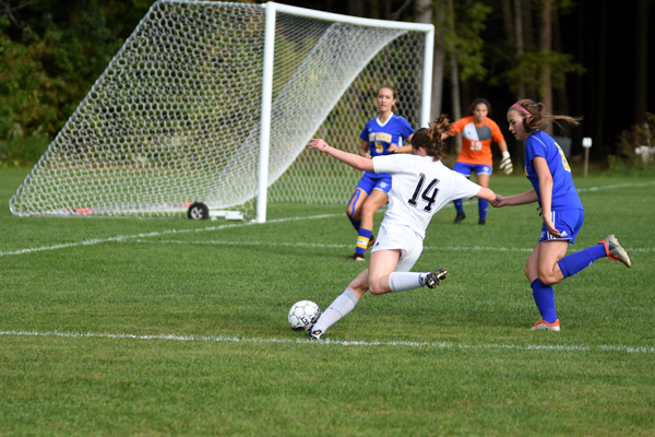 Eleanor Reilly takes a shot during Harwood's win over Lamoille. Photo: Chris Keating