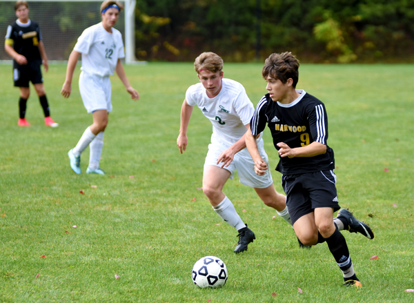 Harwood's Asa Moscowitz dribbles around a GMVS defender in the Highlander's 1-0 win over GMVS on October 7. Photo: Christopher Keating