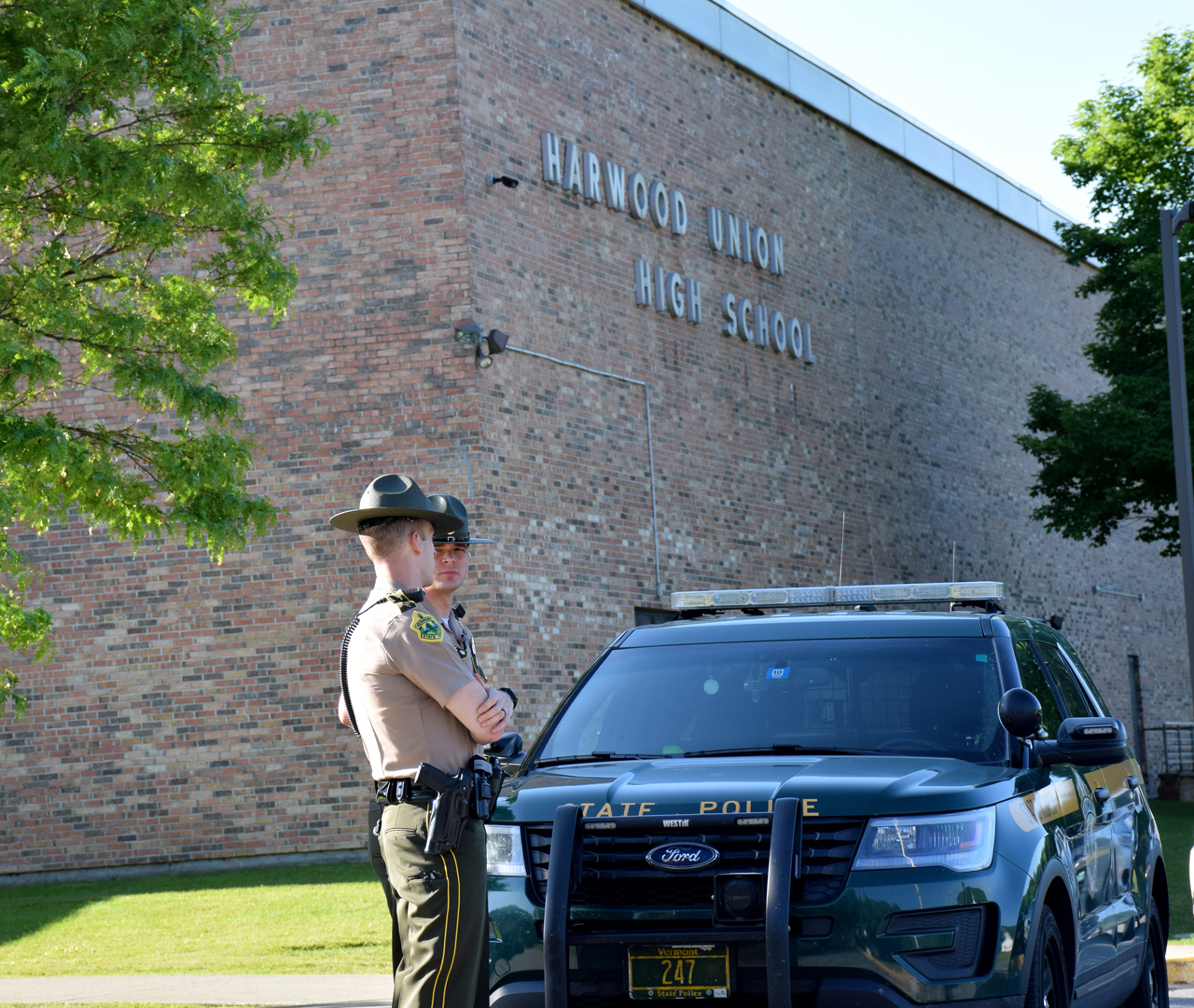 Vermont State Police Sgt. Doll and Tpr. Burrows at Harwood Union High School in Duxbury Wednesday, June 13. Photo: Jeff Knight