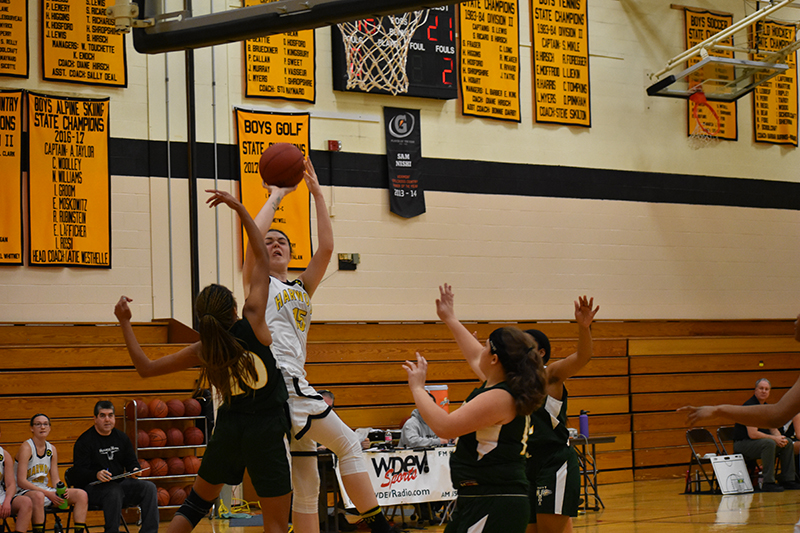 Harwood's Mia Cooper takes a shot. Cooper scored 13 against Montpelier. Photo: Tom Young