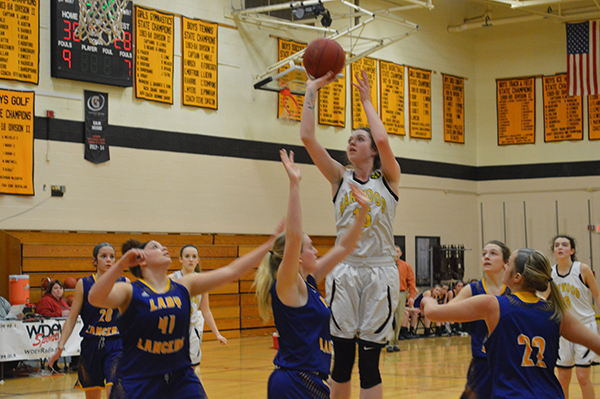 Mia Cooper shoots a hoop for Harwood Union