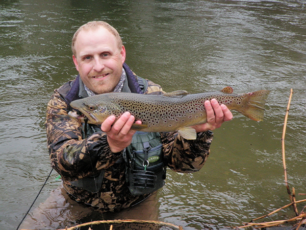 TroutSeason VT Fish & Wildlife photo of Drew Price with an early-season brown trout from a prior year