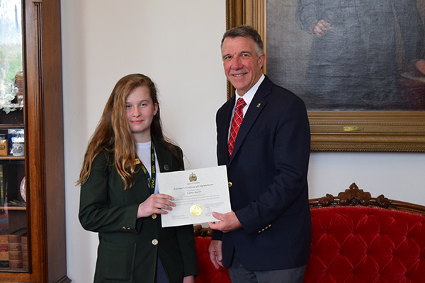 Lindsey Bigelow receives her award from Governor Phil Scott following the end of her six-week session on May 18.