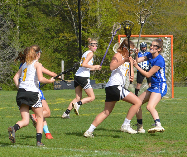 Charlotte Cook tries to outmaneuver a Vergennes player in a May 21 game at home