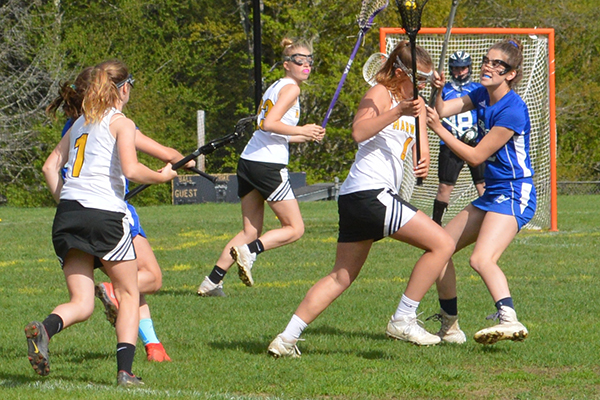 Photo: Katie Martin Charlotte Cook tries to outmaneuver a Vergennes player in a May 21 game at home