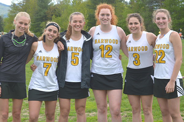 Photo: Katie Martin. Harwood girls' lacrosse played GMVS  for their senior game on May 24. From  left to right: Kayla O'Toole, Dana Marchitelli, Zoe Buffum, Johanna Jarecki, Samantha Widschwenter, Kelly Tynan, Erica Dow, Francie Aiken and head coach Hillary Wheeler.