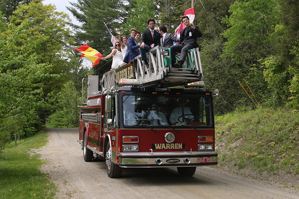 GMVS graduates ushered to commencement atop the Warren Fire Department's ladder truck.