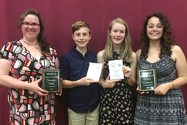 Crossett Brook Middle School students and teachers received awards: left to right, librarian Jen Hill, eighth-grader Adam Porterfield, eighth-grader Maisie Franke, and social studies teacher Grace Gilmour.