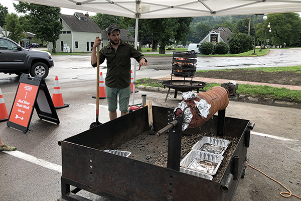 Photo: Robin Morris. Bill Cavanaugh spit-roasts a whole pig for this year's Mad River Taste Week kickoff on August 3
