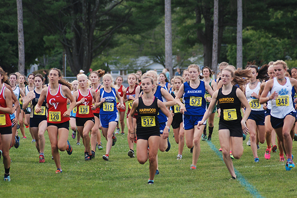 Harwood's Julianne Young, No. 512, and Ava Thurston, No. 5, lead the pack at the start of the girls' varsity race. Thurston placed second and Young was 13th. Photo: Laura Caffry.
