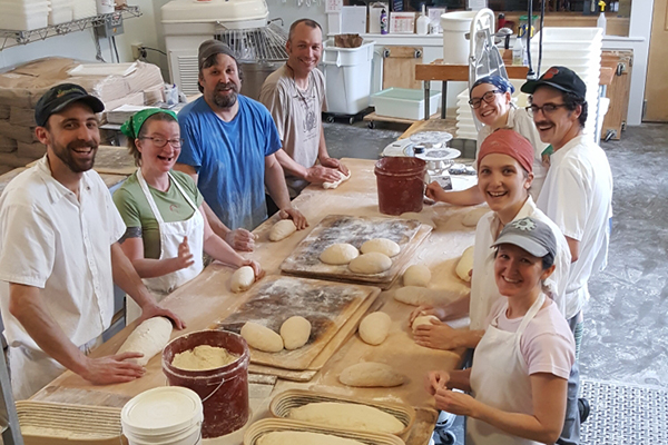 Red Hen Baking Co. employees at work in Middlesex. Red Hen celebrates 20 years this weekend with the Great Vermont Bread Festival. Pictured from left to right: Douglas Clendaniel, Amanda Asthiemer, John Wolfe, Randy George, Eileen Howard, Max Messex, Hannah Lepisko and Sabrina Ripley.