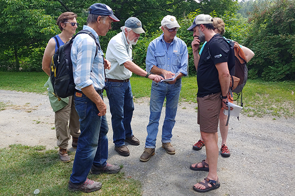 Photo: Corrie Miller Participants discuss dynamic river changes through time at Lareau Farm's river frontage.