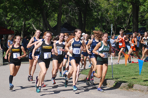 Photo: Laura Caffry. Harwood's Ava Thurston (1) and  Julianne Young (5) compete in the Burlington Invitational on September 7. Thurston placed first with a time of 18:50.