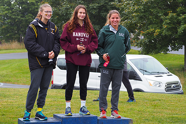 Photo: Ann Zetterstrom. Sophomore Britta Zetterstrom, left, placed third for the Harwood girls at the Randolph Invitational.