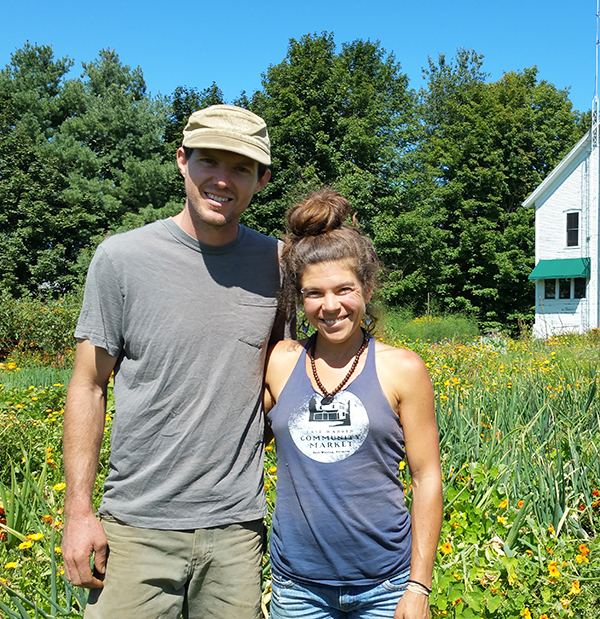 Photo: Anne Burling. Zeb Swick and Samantha Duchaine, owners of Alpenglow Farm, have purchased 50 acres of conserved farmland in East Warren.