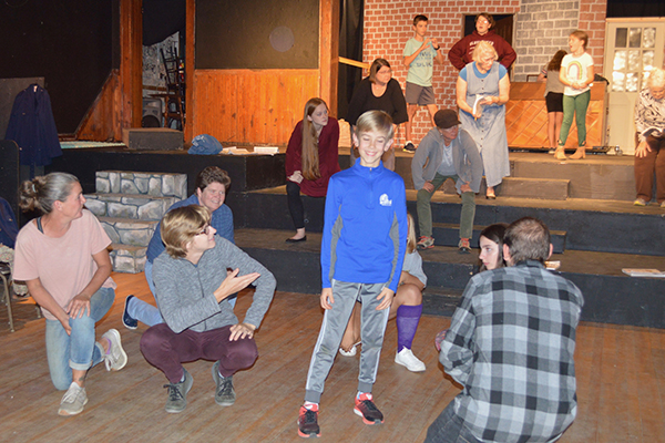 "Tarin Askew (one of two playing the title role in ""Oliver!"") rehearses a dance number with the cast."