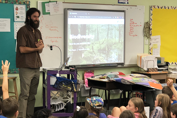 Eric Hagen, UVM grad student and consultant with the Vermont Alliance for Half Earth, speaks to Warren School third- through sixth-graders about biodiversity and the Half Earth Project in preparation for this Thursday's bioblitz.