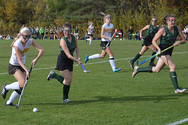Photo: Katie Martin. Annie Fennelly takes the ball down the sideline in a game against St. Johnsbury on October 10. The game would end in an overtime tie 1-1.