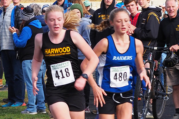 Photo: Ann Zetterstrom. Harwood girls won the NVAC Mountain Division Championship on Saturday, October 19. It was a nail-biter down to the end with a very competitive field of girls from across the entire division. Pictured: Caelyn McDonough races to the finish line to take 10th place overall